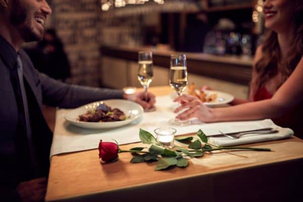 Couple-at-valentines-dinner-with-rose
