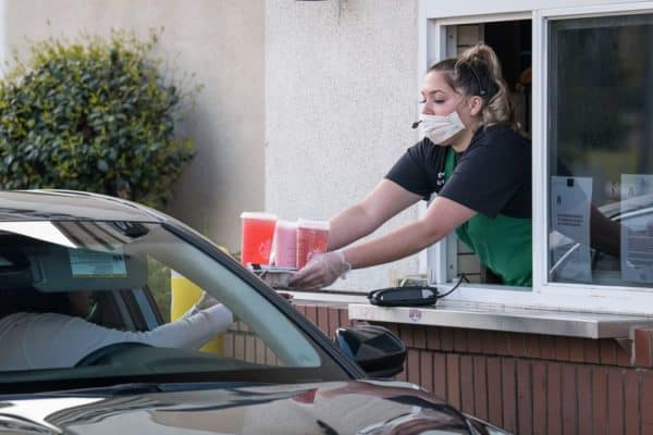 Fast-food-drive-thru-worker-with-mask-and-gloves